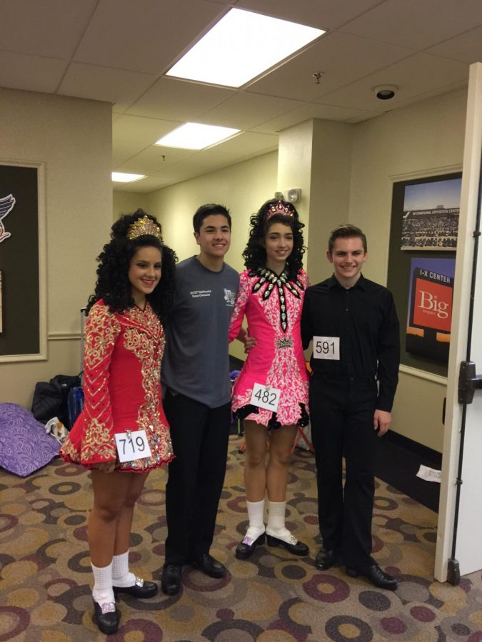 Lupton poses with dance teammates at the North Coast Feis in February 2017, in her solo dress. She explains that these dresses can be heavy and expensive with some costing up to $2,000.