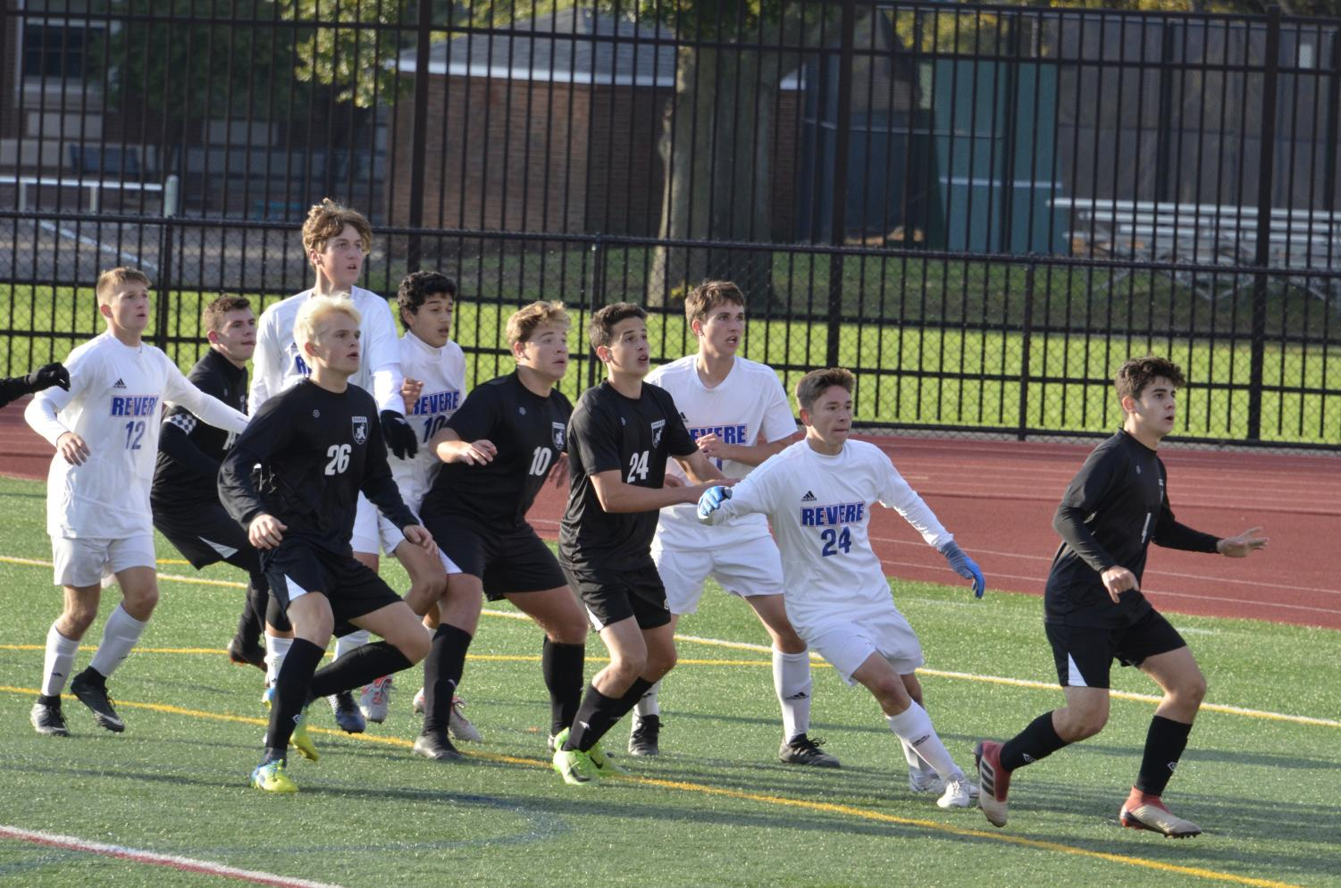 Varsity boys soccer team prepares for the incoming corner kick. They faced the Revere Minutemen on Oct. 13.