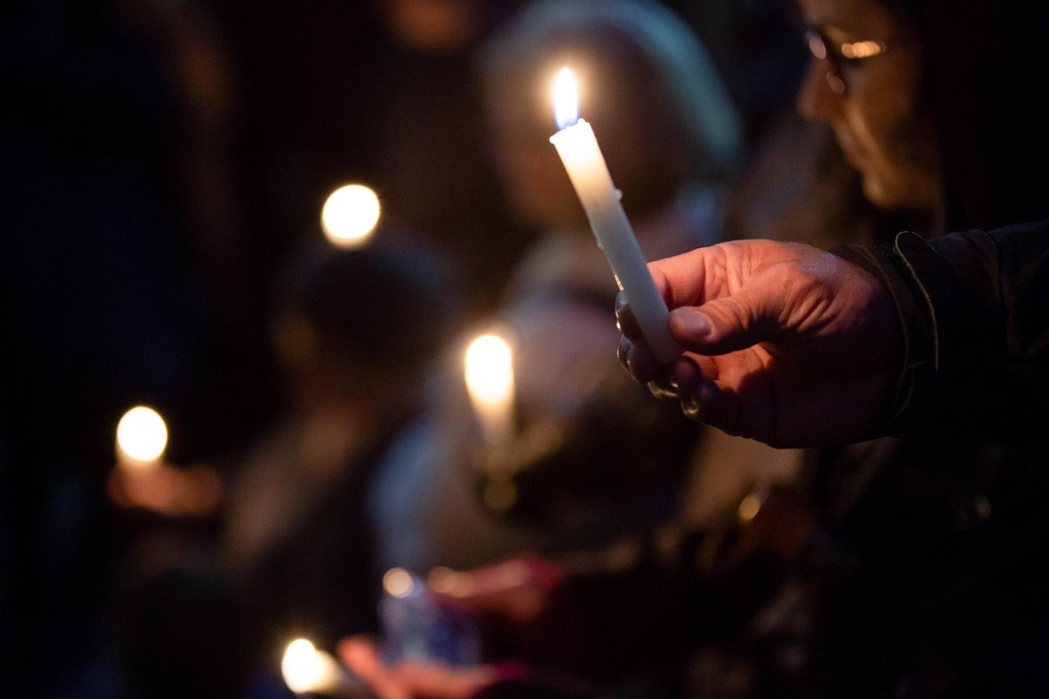 Mourners light candles at a vigil for the victims of the Pittsburgh synagogue shooting. The victims were the latest victims of the mass shooting cycle. The mass shooting cycle needs to end, but the only way to end it is by voting.