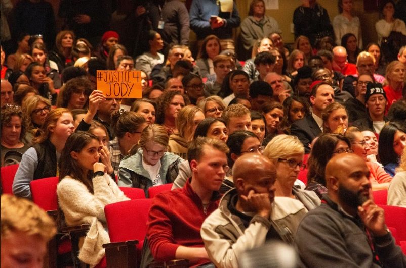More than 900 people filled the large auditorium Nov. 8, standing in the back if they could not find a seat. The meeting devolved into jeers and shouting soon after it began, and about halfway through, students took the stage and the microphone.