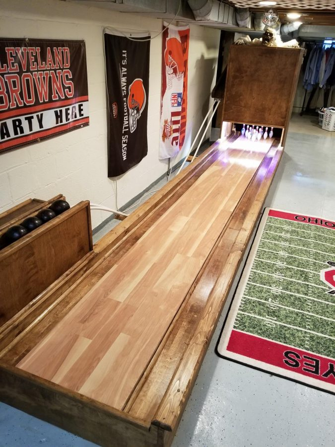 Zannelli is the handy man of his family. He built a half-scale bowling alley in his basement for his kids to enjoy.