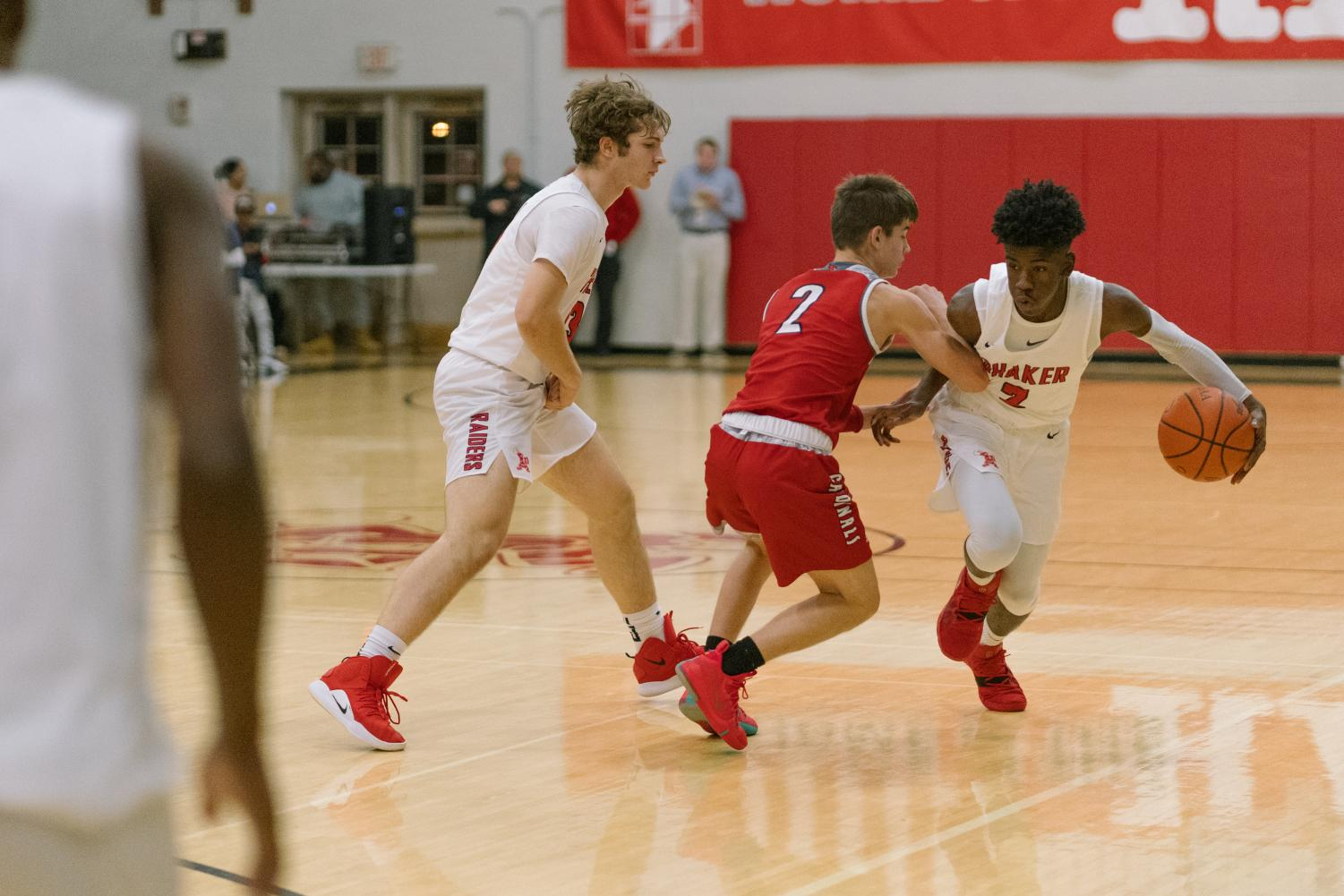 Freshman point guard Danny Young Jr. receives a screen from senior Harry Carroll against Mentor on Friday night.