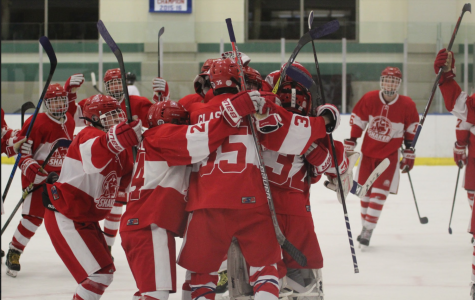 The varsity hockey team celebrates after a 1-0 win against University School on Saturday afternoon at Cleveland Heights.
