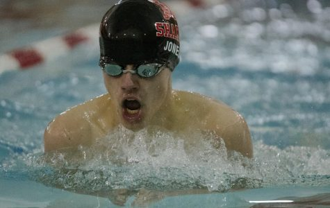Sophomore Logan Jones swims at Woodbury Elementary School on Friday against Akron Firestone.