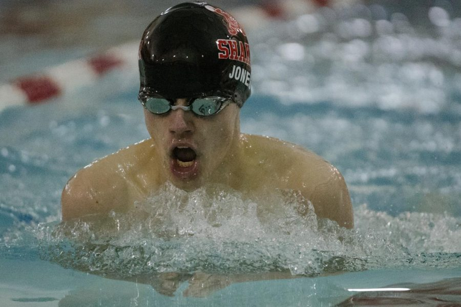Sophomore+Logan+Jones+swims+at+Woodbury+Elementary+School+on+Friday+against+Akron+Firestone.