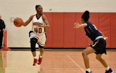 Senior Anajiah Wallace takes the ball up the floor against Euclid this past Wednesday.