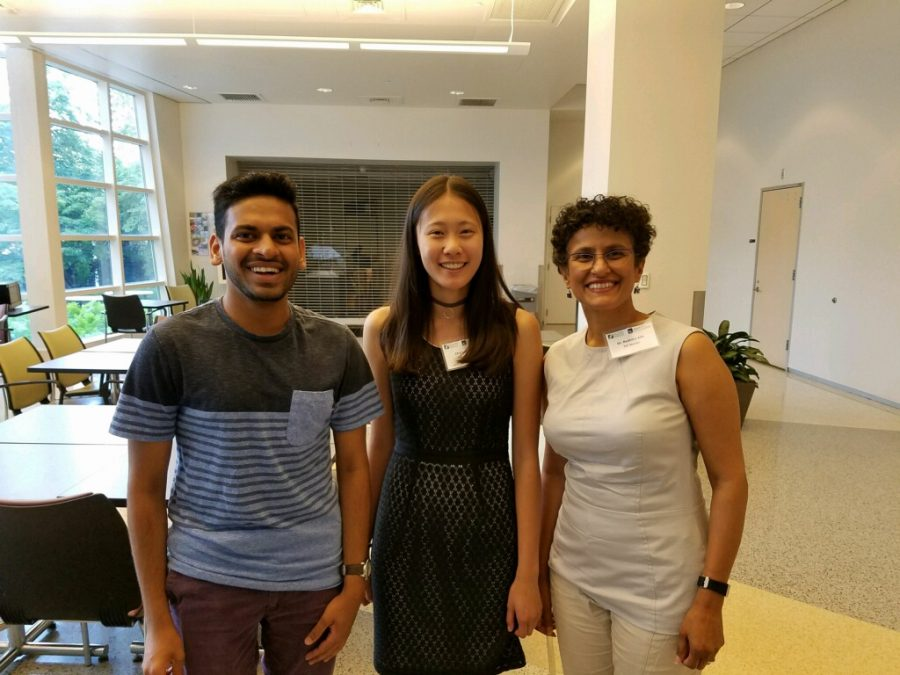 "Lo with mentors from the Young Scientist Foundation. They guided Lo while she ""worked in a skin development lab, mainly researching how a certain component of something called the polycomb repressive complex two,  and how it affected skin development."""