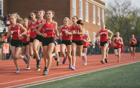 Multiple runners from Shaker compete in the 1600m at a dual meet against Mentor.