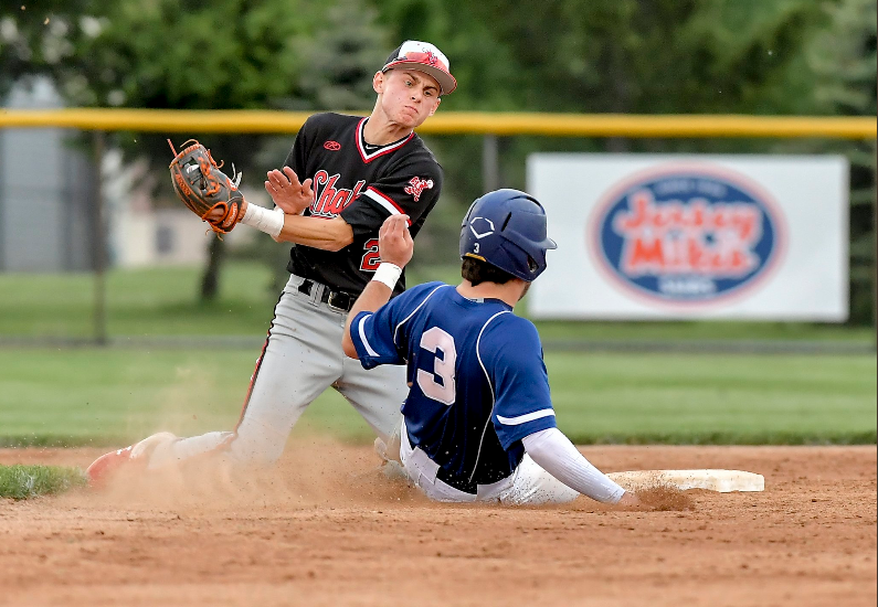Senior shortstop and Bowling Green commit Nathan Rose attempts to tag a base runner out  during the district semifinal last Tuesday. Hudson would win 2-0.