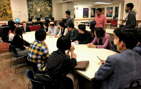 Delegates from South Korea listen to high school students.
