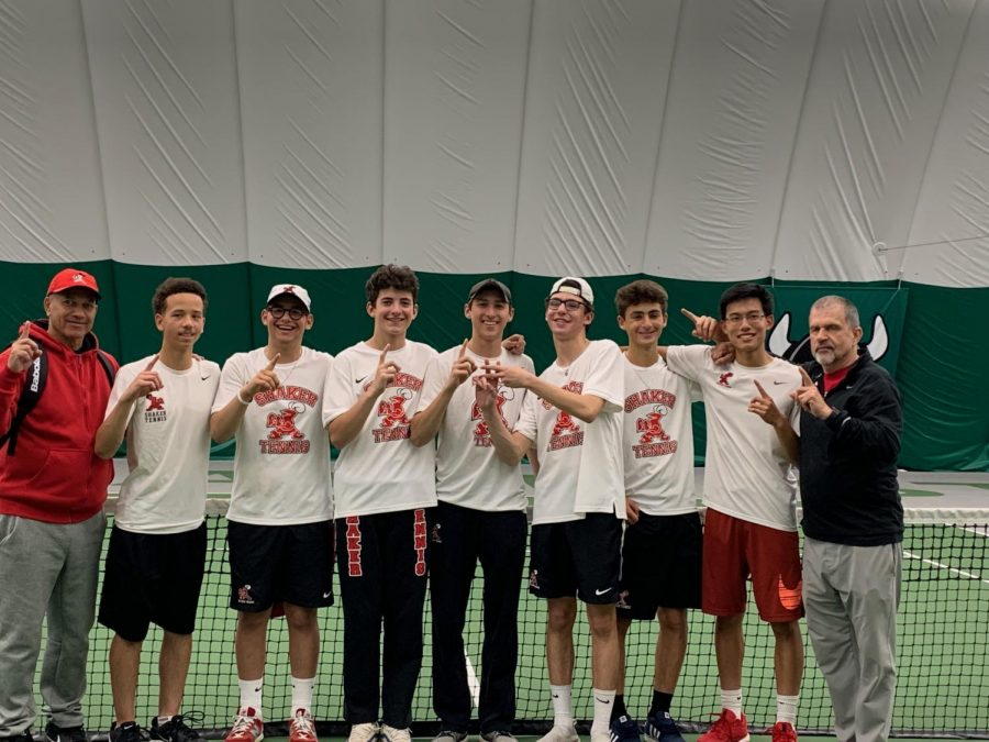 The varsity tennis team celebrates after winning the Greater Cleveland Conference Tournament last Friday at Cleveland State.