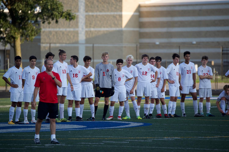 The men's varsity soccer team line up before a game against Brunswick Aug. 28.