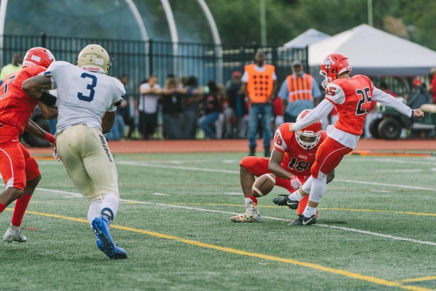 Junior Carson Fowler kicks a field goal.