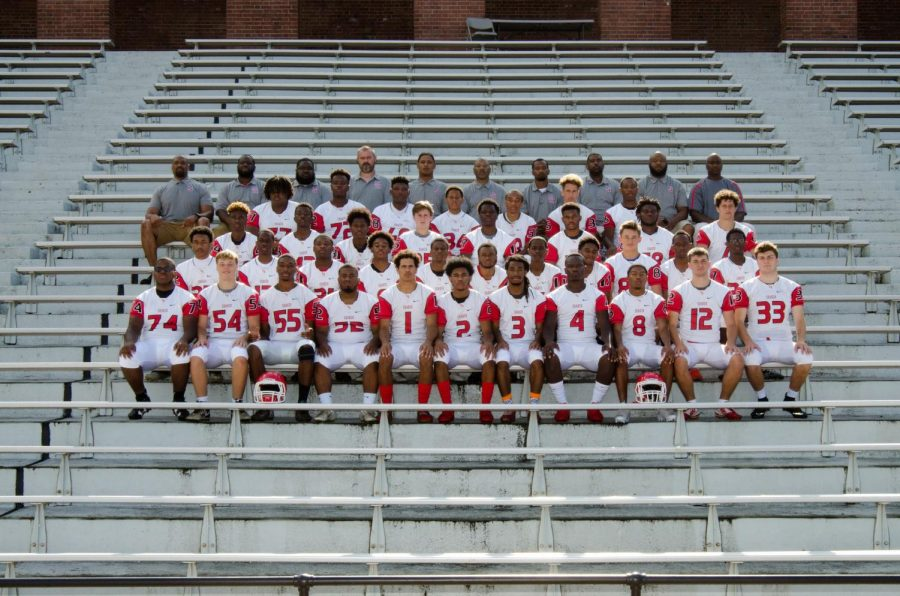 Harrell is pictured in the top row, fifth from the left, alongside other coaches on the 2018 football team.