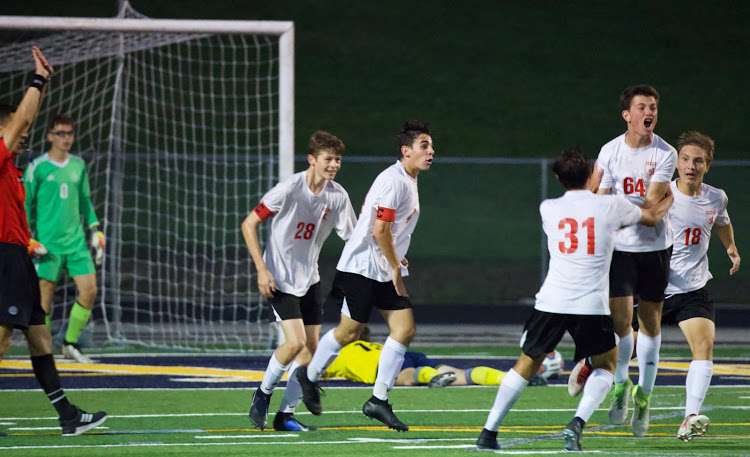 Sophomore Luke Stefanksi celebrates with his team after scoring a goal versus Copley last Thursday night.