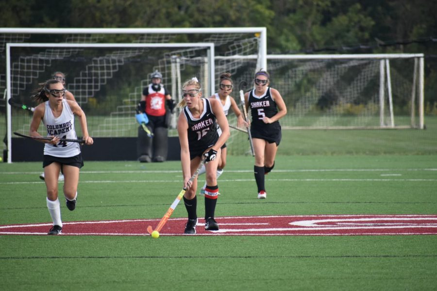 Senior Lora Clarke dribbles the ball in field hockey's game against Columbus Academy.