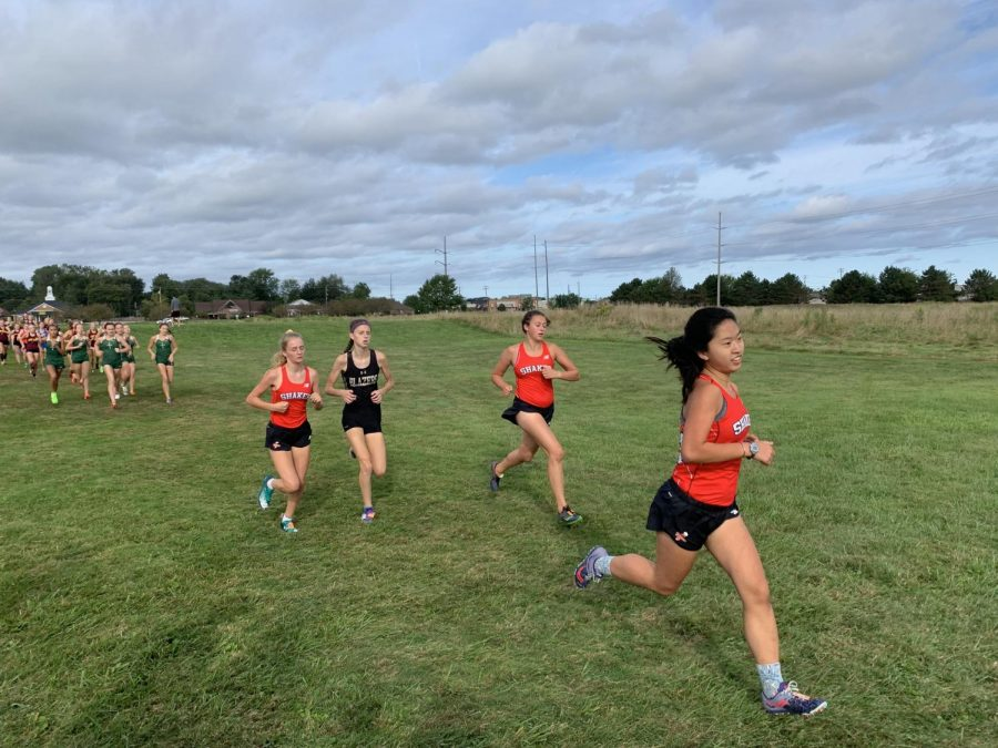 Mia Compton-Engle, Juliet Tonkin, and Anna Carpenter compete in the Avon Lake Earlybird Invitational.