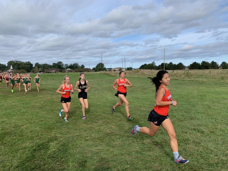 Mia Compton-Engle, Juliet Tonkin, and Anna Carpenter compete in the Avon Lake Earlybird Invitational.