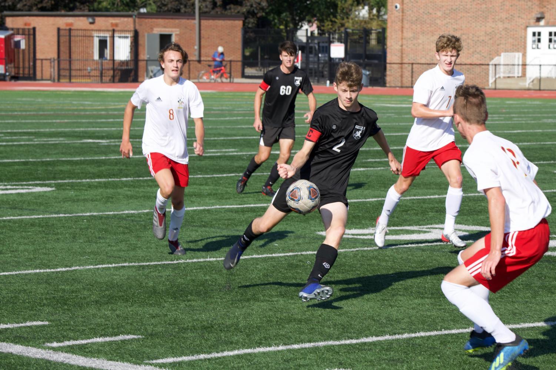 Junior Davis Belk plays in the boy's soccer game against Brecksville.