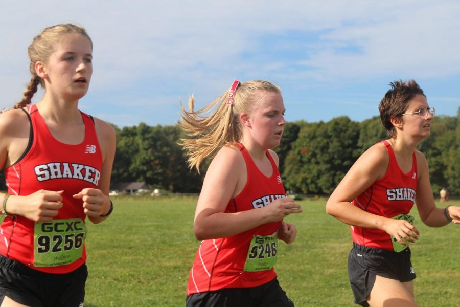 Anna Miller, Audrey Burnard and Louise Spadoni run in the girl's open race at the Madison cross country meet on Saturday.
