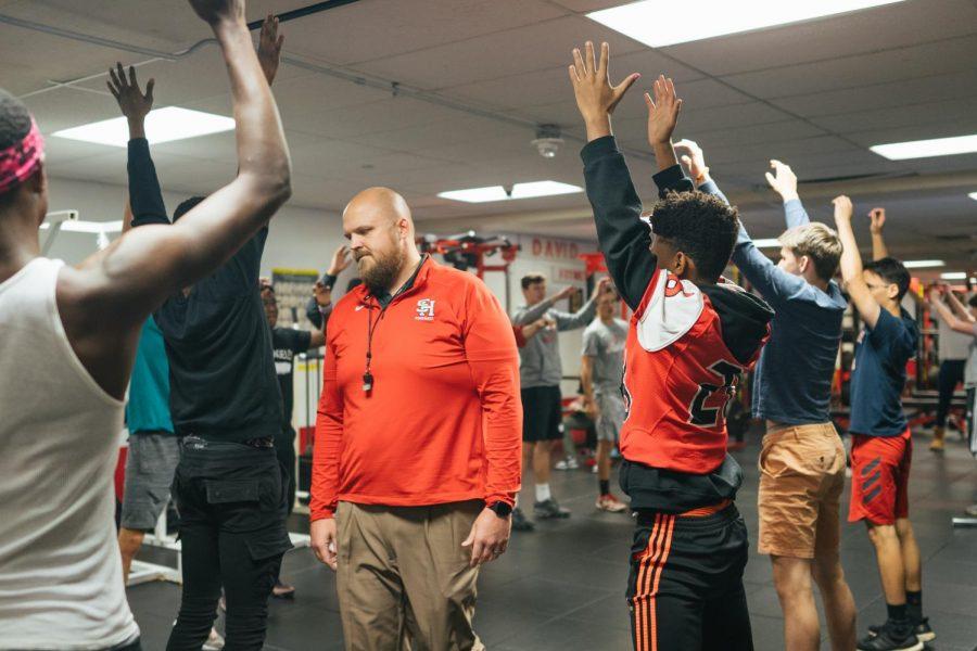 Nicholson teaches weight training class during tenth period.