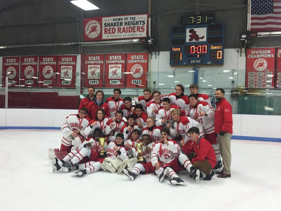 The varsity hockey team celebrates after winning the annual Thornton Park Tournament.