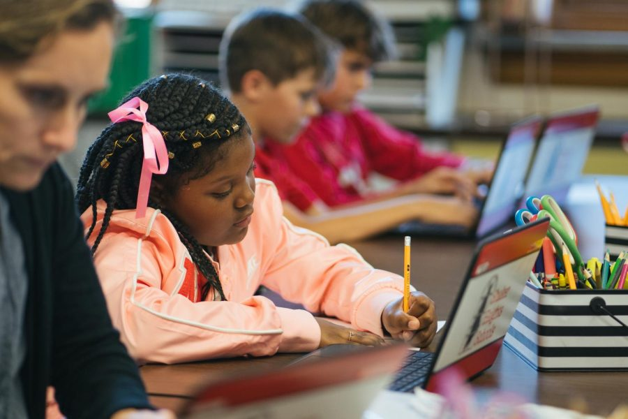 A student completes an assignment with her Chromebook in an Onaway Elementary School classroom.