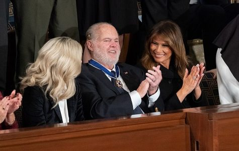 First Lady Melania Trump applauds Rush Limbaugh after presenting him with the Presidential Medal of Freedom during President Donald J. Trump's State of the Union address.