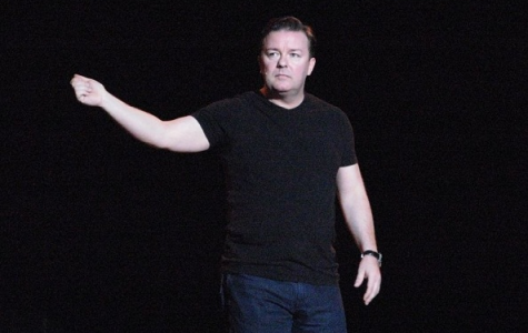 Ricky Gervais performs in a stand-up comedy show