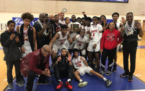 The men's basketball team after winning their district on Saturday.