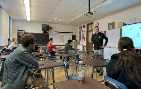 Math teacher Ray Durban instructs his students in school for the last time before the state-mandated, three-week closure, ordered to slow the spread of the COVID-19 virus, begins.