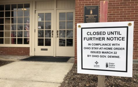 A sign is posted outside of the administration building stating closure until further notice.