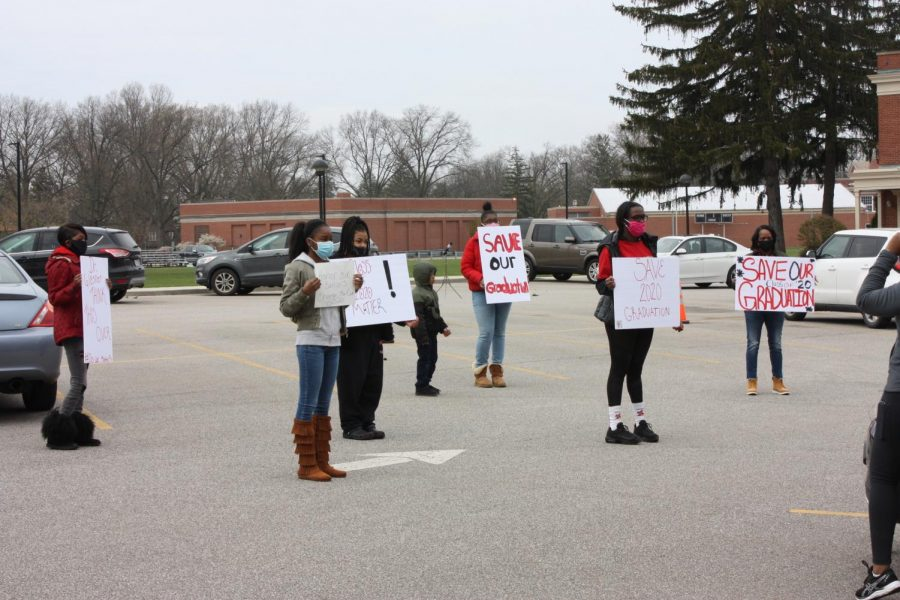 Students and families protest April 24 in the administration parking lot.