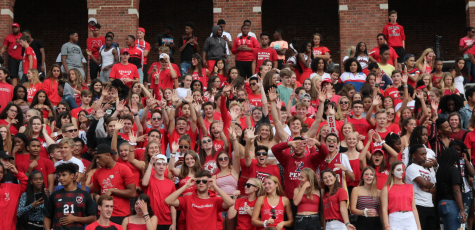 Seniors and other students cheer for the football team as they beat Benedictine High School 23-21 Aug. 31, 2018.