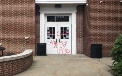 Lower cafeteria door spray painted after protests yesterday.