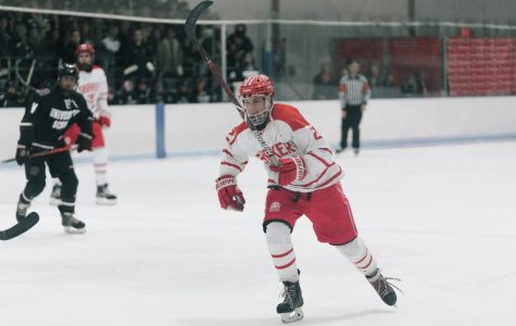 Josh Floyd wears the hockey team's white uniform, one of their three sets, when playing University School.