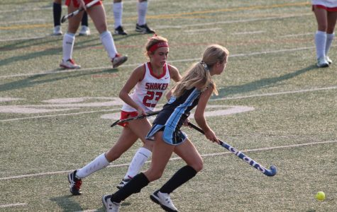 Freshman Charlotte Glasper plays at the varsity field hockey game against Magnificat.