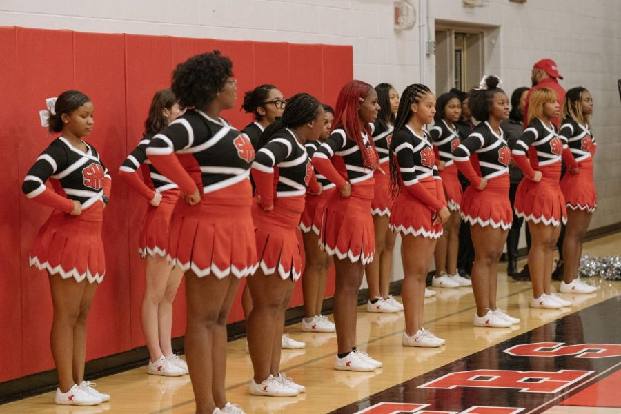 The majority black raider cheerleaders rally on the sideline during a Jan. 8 home game against Euclid.
