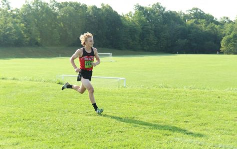 Junior Maclin Stupay competes in the men's varsity race at the US Tri-Meet.