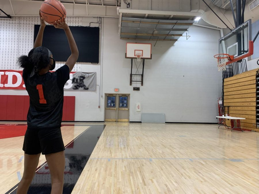 Sophomore Meilani Walker wears her mask as she plays basketball in a practice.