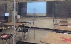 The view from a student desk during today's debut of concurrent learning is blurred by the flexible partition attached to the desk.