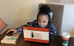 Lailah Walker, a second grader at Lomond Elementary School, participates in remote learning.