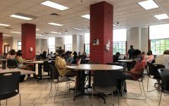 Students sit spread out wearing masks in the lower cafeteria for study hall.