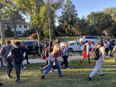 Students were instructed to move from the front oval to the stadium field following an evacuation due to an unknown threat.