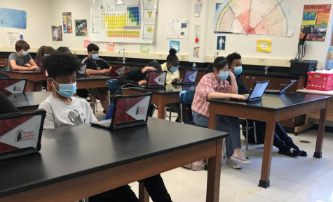 Students complete work on their district-issued Chrombooks in science class.