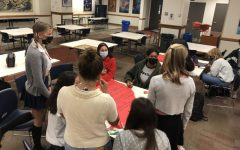 Senior Student Council members work in the Upper Cafeteria to plan this years Homecoming dance.