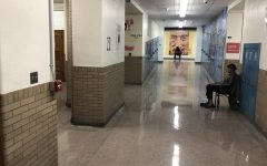 Assistant Principal Rebekah Sharpe sits, monitoring the hallways near the second floor fire alarm that was pulled